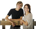 Happy Teen Couple by the Fence Royalty Free Stock Photo