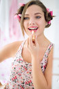 Happy teen girl applying lipstick Royalty Free Stock Photo