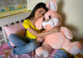 Happy teen girl with bunny toy Royalty Free Stock Photo