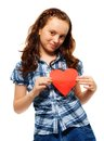 Happy teen girl holding red heart symbol made paper expressing love affection standing isolated whtie Stock Photos