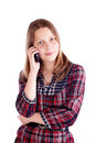 Happy teen girl talking on mobile phone studio shot Stock Photography