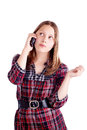 Happy teen girl talking on mobile phone studio shot Royalty Free Stock Photo