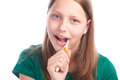 Happy teen girl with toothbrush studio shot Royalty Free Stock Photography