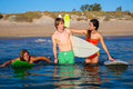 Happy teen surfers talking on beach shore beautiful smiling Stock Photos