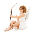 Happy teenage angel girl with bow and arrow holidays valentine s day costumes concept Royalty Free Stock Photo