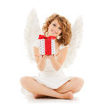 Happy teenage angel girl with christmas gift holidays xmas and costumes concept Royalty Free Stock Photo