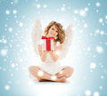 Happy teenage angel girl with christmas gift Royalty Free Stock Photo