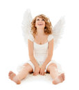Happy teenage angel girl religion faith holidays and costumes concept Royalty Free Stock Image