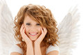 Happy teenage angel girl religion faith holidays and costumes concept Royalty Free Stock Photos