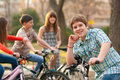 Happy teenage boy on bicycle with friends Royalty Free Stock Images