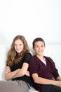 Happy teenage couple sitting together Royalty Free Stock Images
