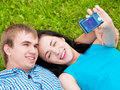 Happy teenage couple taking picture Royalty Free Stock Photo