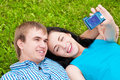 Happy teenage couple taking picture Royalty Free Stock Photos
