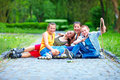 Happy teenage friends playing outdoors four Royalty Free Stock Images