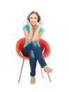 Happy teenage girl in big headphones Royalty Free Stock Image