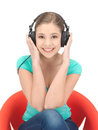 Happy teenage girl in big headphones Royalty Free Stock Photo
