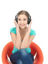 Happy teenage girl in big headphones Stock Photography