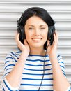 Happy teenage girl in big headphones Royalty Free Stock Photography