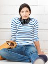Happy teenage girl in big headphones Royalty Free Stock Images