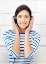 Happy teenage girl in big headphones picture of Stock Photo