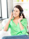 Happy teenage girl in big headphones picture of Royalty Free Stock Photos