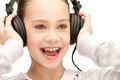 Happy teenage girl in big headphones picture of Royalty Free Stock Photo