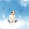Happy teenage girl in big headphones picture of sitting on cloud Stock Image