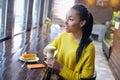 Happy teenage girl enjoying her coffee break Royalty Free Stock Photo