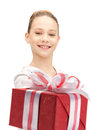Happy teenage girl with gift box picture of Stock Photo