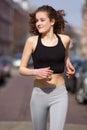 Happy teenage girl jogging outdoors