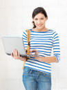 Happy teenage girl with laptop computer picture of Stock Photography