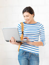 Happy teenage girl with laptop computer picture of Royalty Free Stock Photo