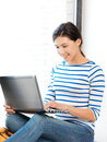 Happy teenage girl with laptop computer Royalty Free Stock Photo