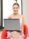 Happy teenage girl with laptop computer picture of Royalty Free Stock Images