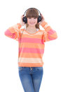 Happy teenage girl listening music in headphones isolated on whi white background Stock Photo