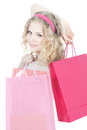 Happy teenage girl with pink shopping bags Stock Photo