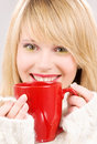 Happy teenage girl with red mug Stock Images