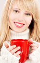 Happy teenage girl with red mug Stock Photos