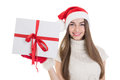 Happy teenage girl with santa hat and big gift box cute caucasian white red bow smiling looking at camera isolated on white Stock Photos