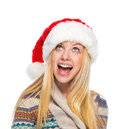 Happy teenage girl in santa hat looking on copy space portrait of Stock Photo