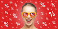 Happy teenage girl in shades with percentage signs Royalty Free Stock Photo