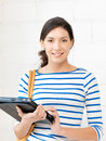 Happy teenage girl with tablet pc computer picture of Stock Photography