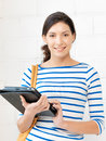 Happy teenage girl with tablet pc computer picture of Stock Image