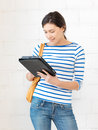 Happy teenage girl with tablet pc computer picture of Royalty Free Stock Photos