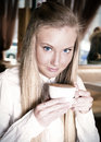 Happy teenage girl teenage girl holding a cup of hot drink Royalty Free Stock Images