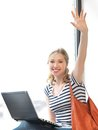 Happy teenage girl waving a greeting with laptop Stock Photos