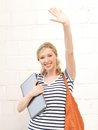 Happy teenage girl waving a greeting with laptop Royalty Free Stock Photography
