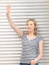 Happy teenage girl waving a greeting picture of Royalty Free Stock Photo