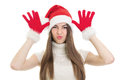 Happy teenage girl wearing santa beanie having fun beautiful young caucasian claus making funny facial expression and holding Stock Images