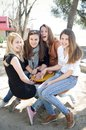 Happy teenage girls group of outside at the playground Royalty Free Stock Images